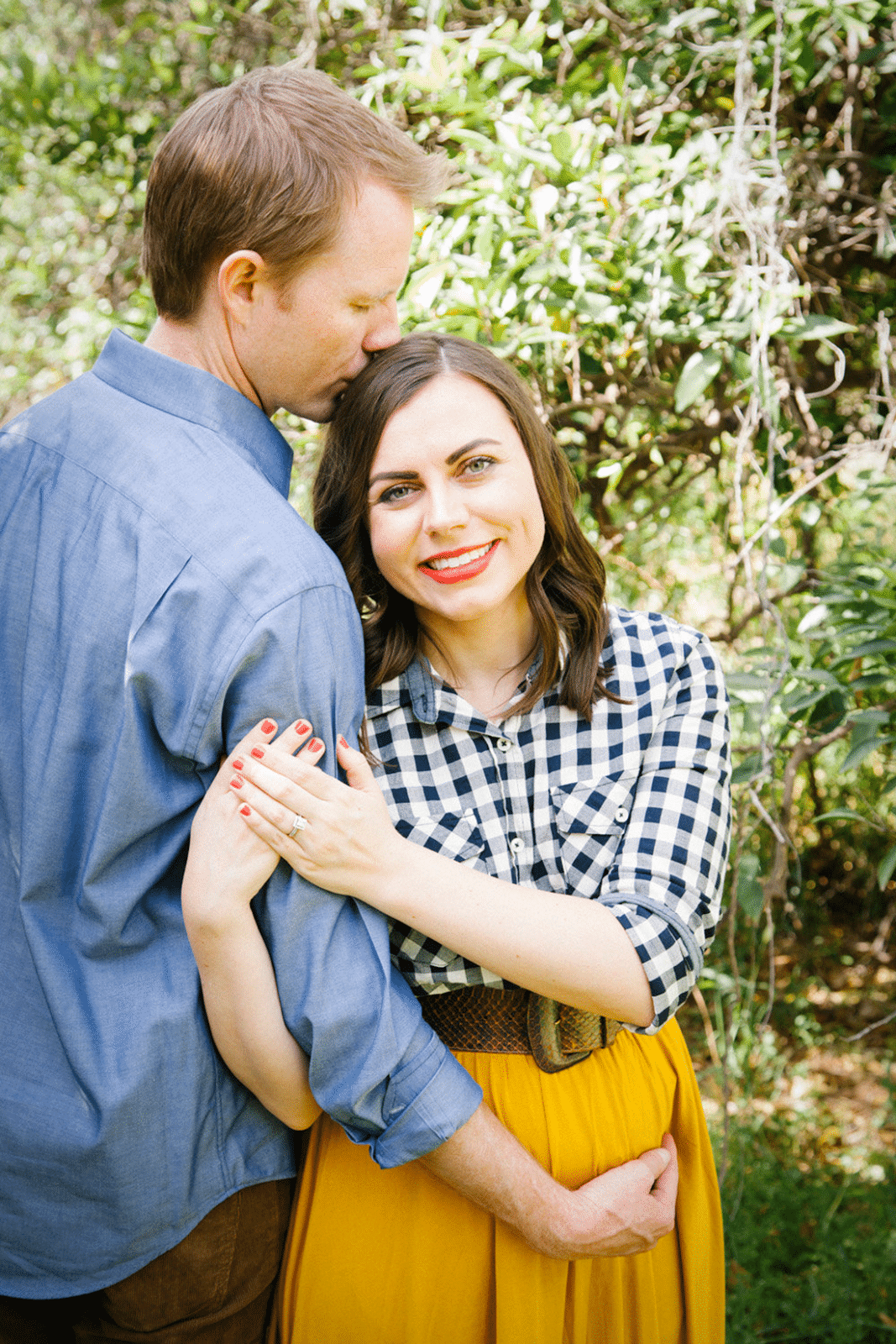 Such a cute maternity photo shoot idea! Love this maternity photo idea with the couple showing their love and that bump!