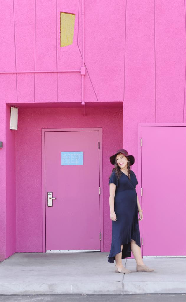 Blue knit dress pink wall